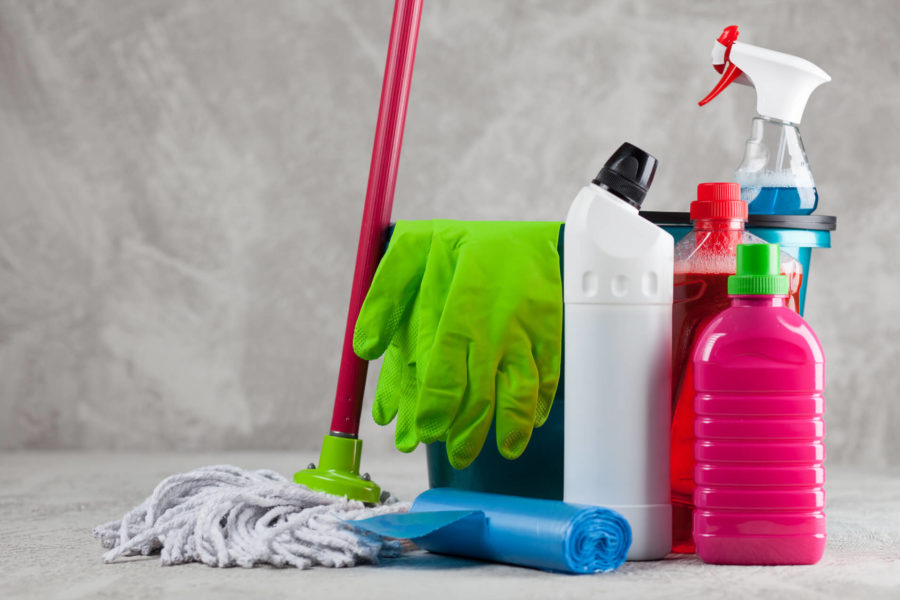 A bucket, a mop, and different sprays and chemicals
