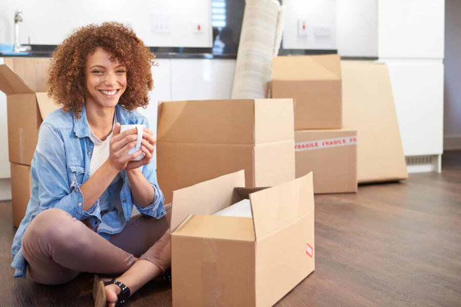 A woman with packages smiling