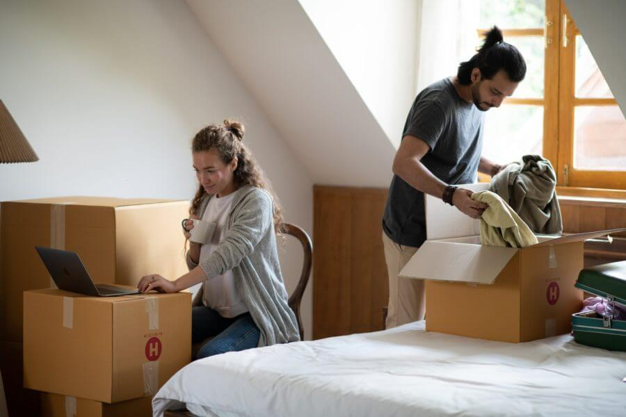 A woman and man piling packages