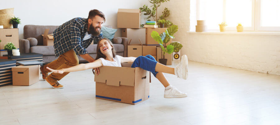 Young man and a girl with cardboard boxes