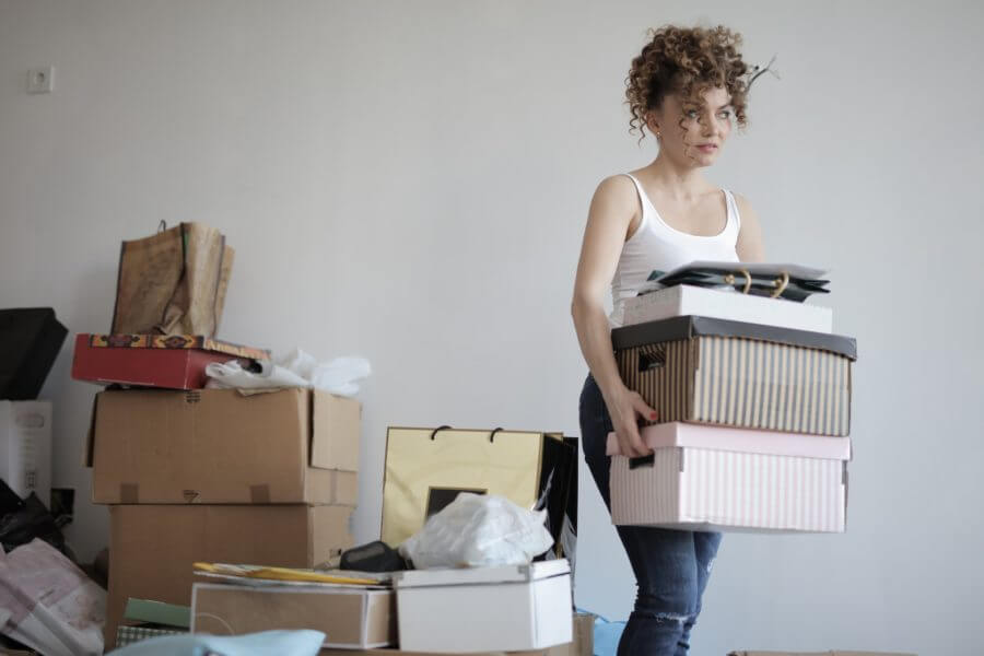 a girl decluttering her home and getting ready for long-distance moving