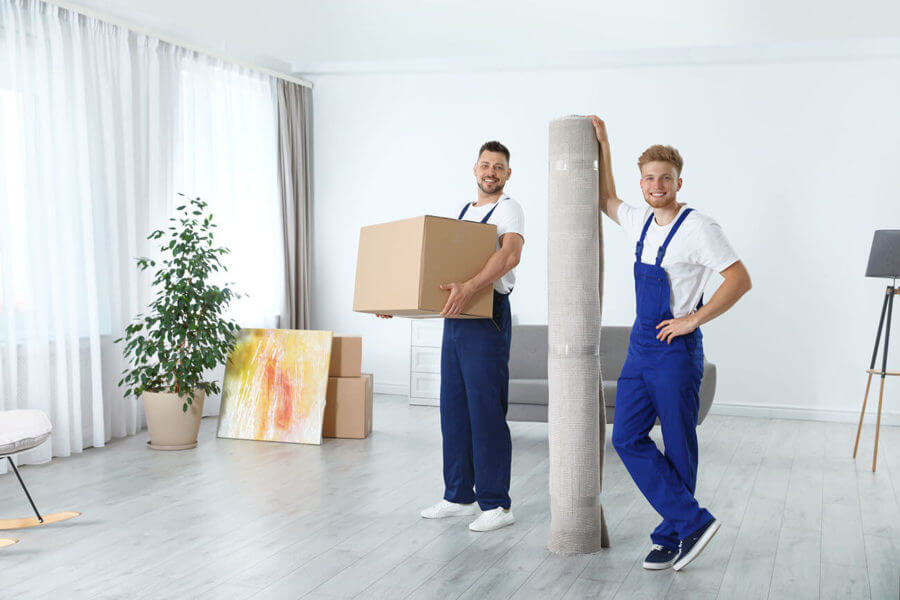 two cross-country movers carrying stuff for a customer that's long-distance moving